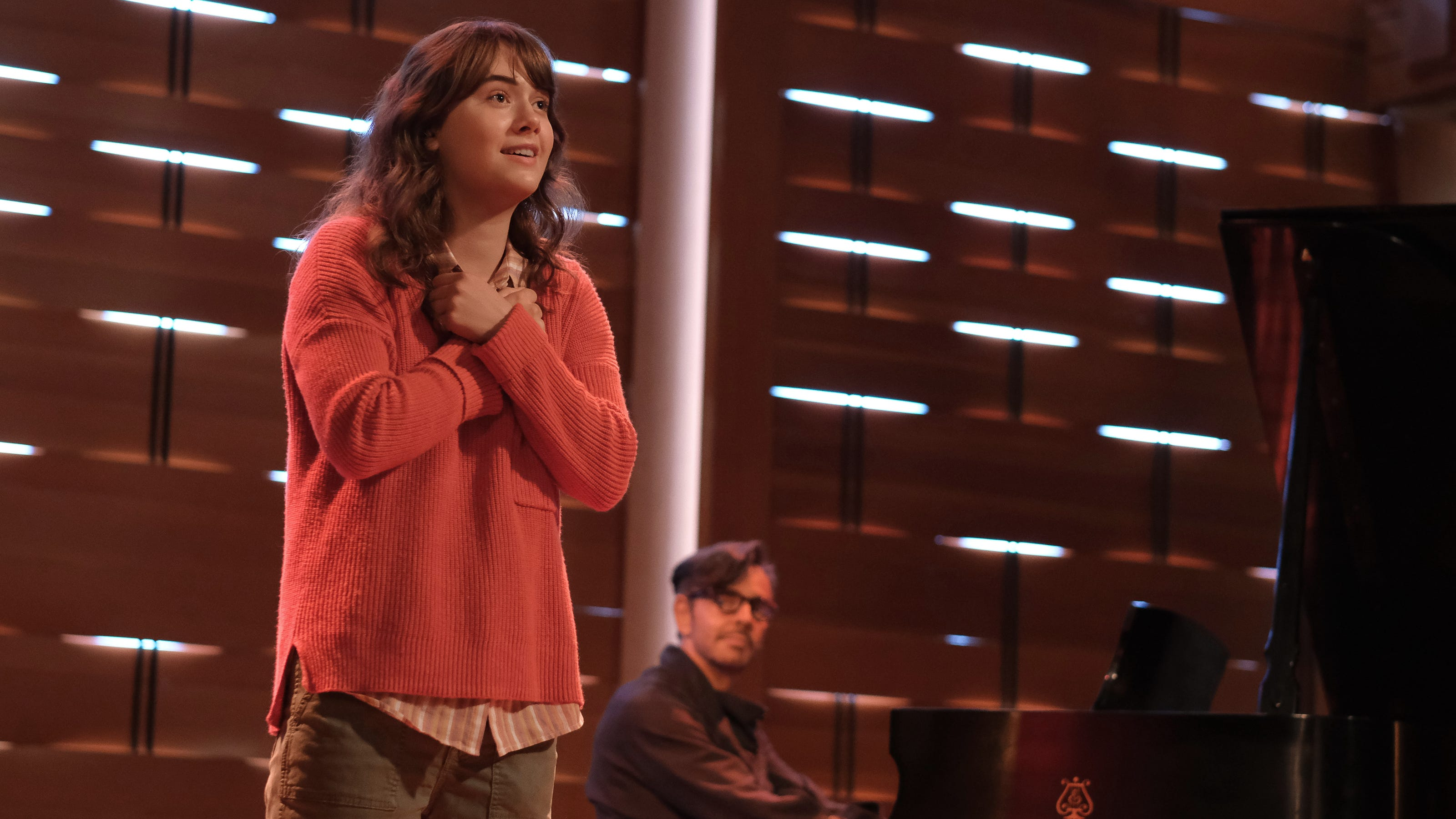 """A still from """"CODA"""" of Ruby singing in her audition"""