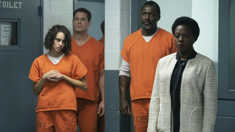 """A still from """"The Suicide Squad"""" of Amanda Waller with Ratcatcher 2, Bloodsport, and Peacemaker in prison"""