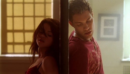 A still from 'Another Cinderella Story' of Mary and Joey dancing on opposite sides of a mirror