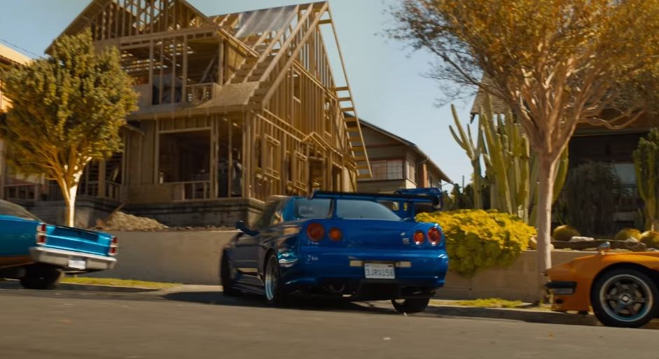 Brian shows up to the extended family barbecue in his blue Nissan Skyline.