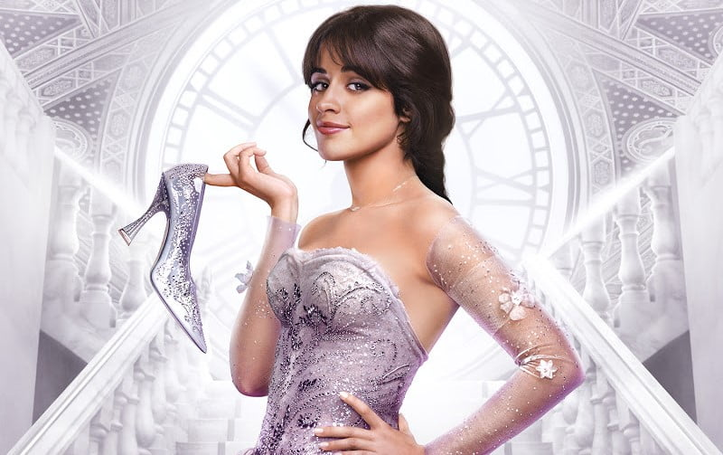 A promotional image from 'Cinderella' (2021) of Camila Cabello as Cinderella holding her glass slipper