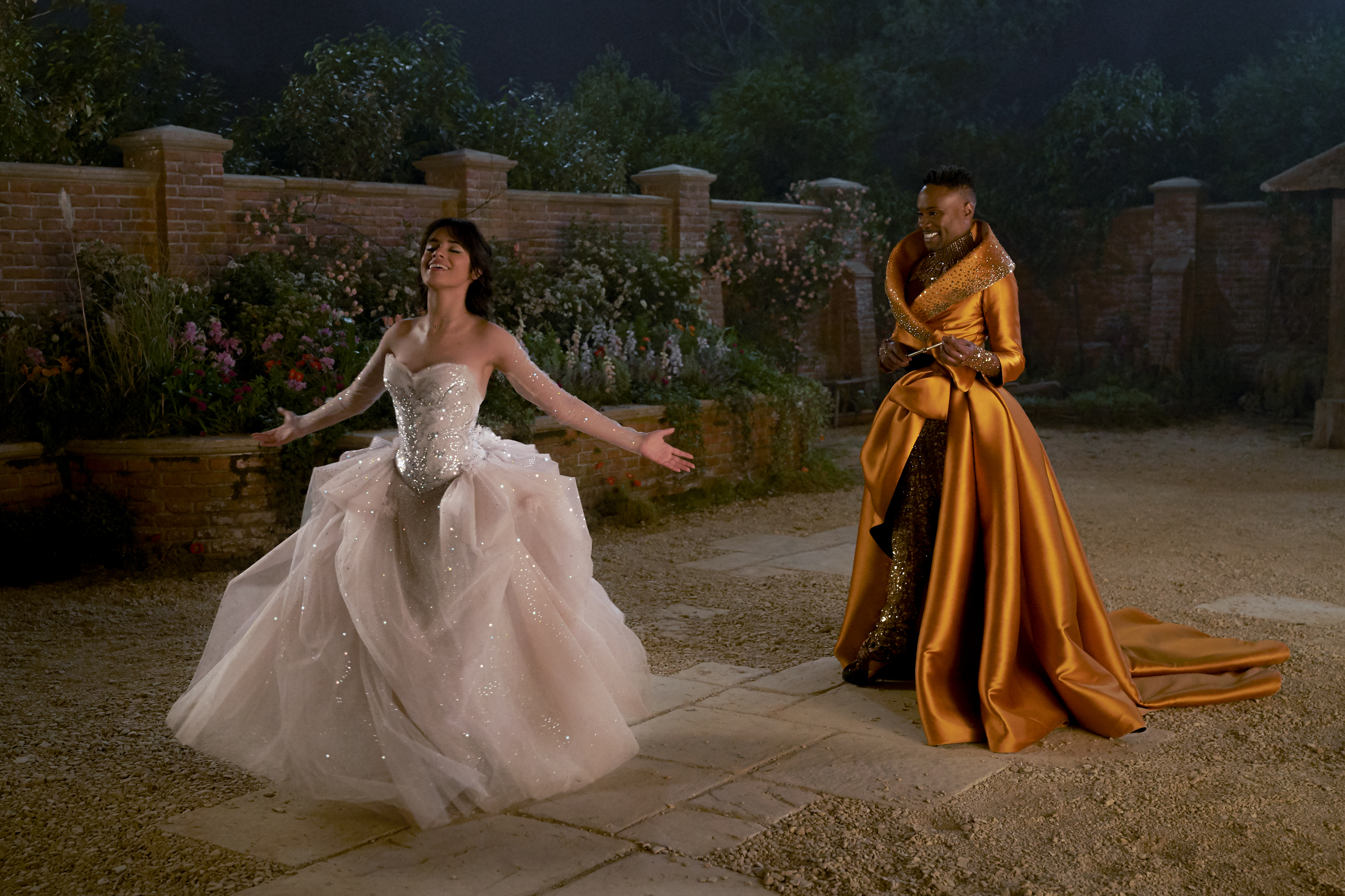 A still from 'Cinderella' (2021) of Billy Porter as the Fabulous Godmother watching Cinderella