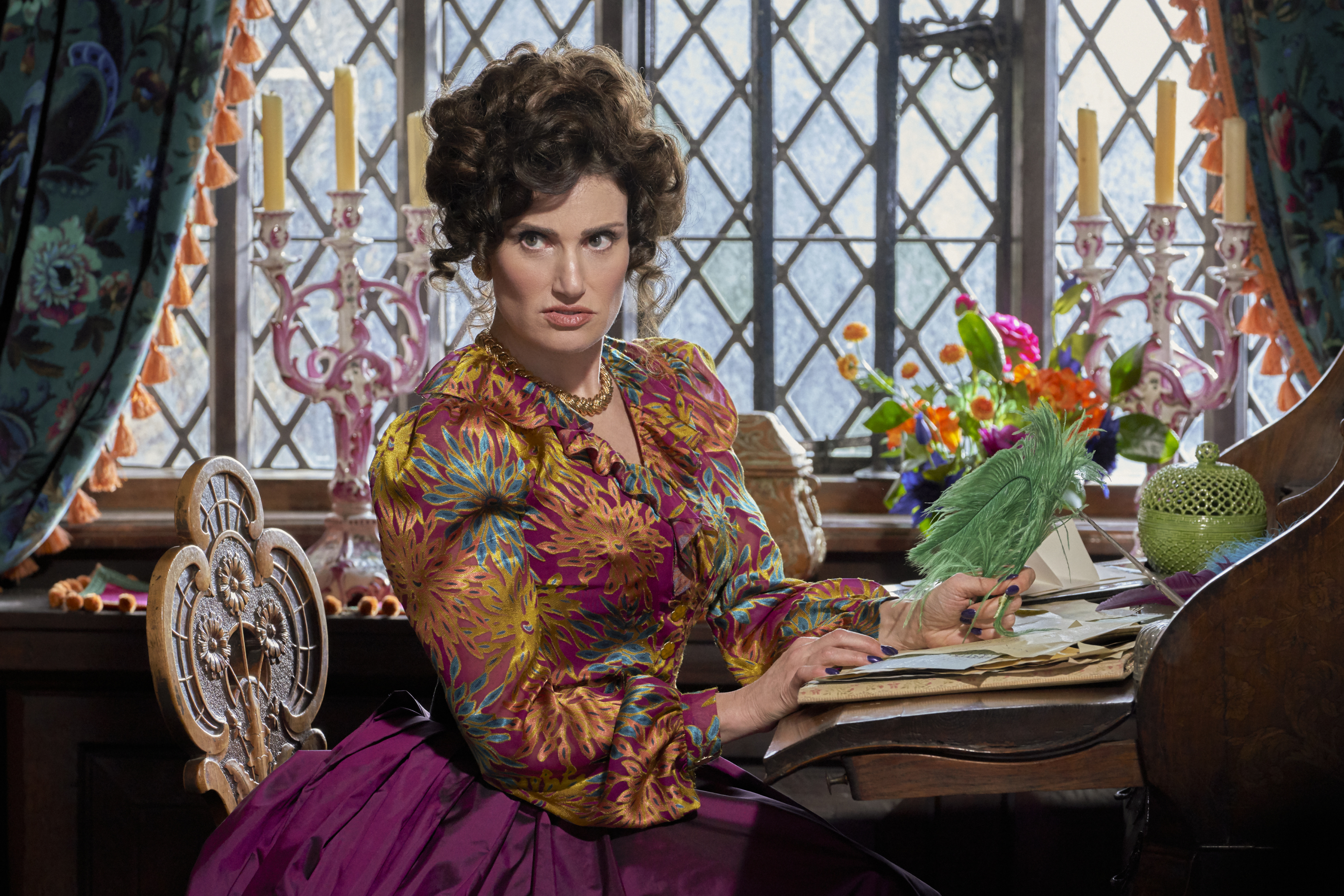 A still from 'Cinderella' (2021) of Idina Menzel as the evil stepmother