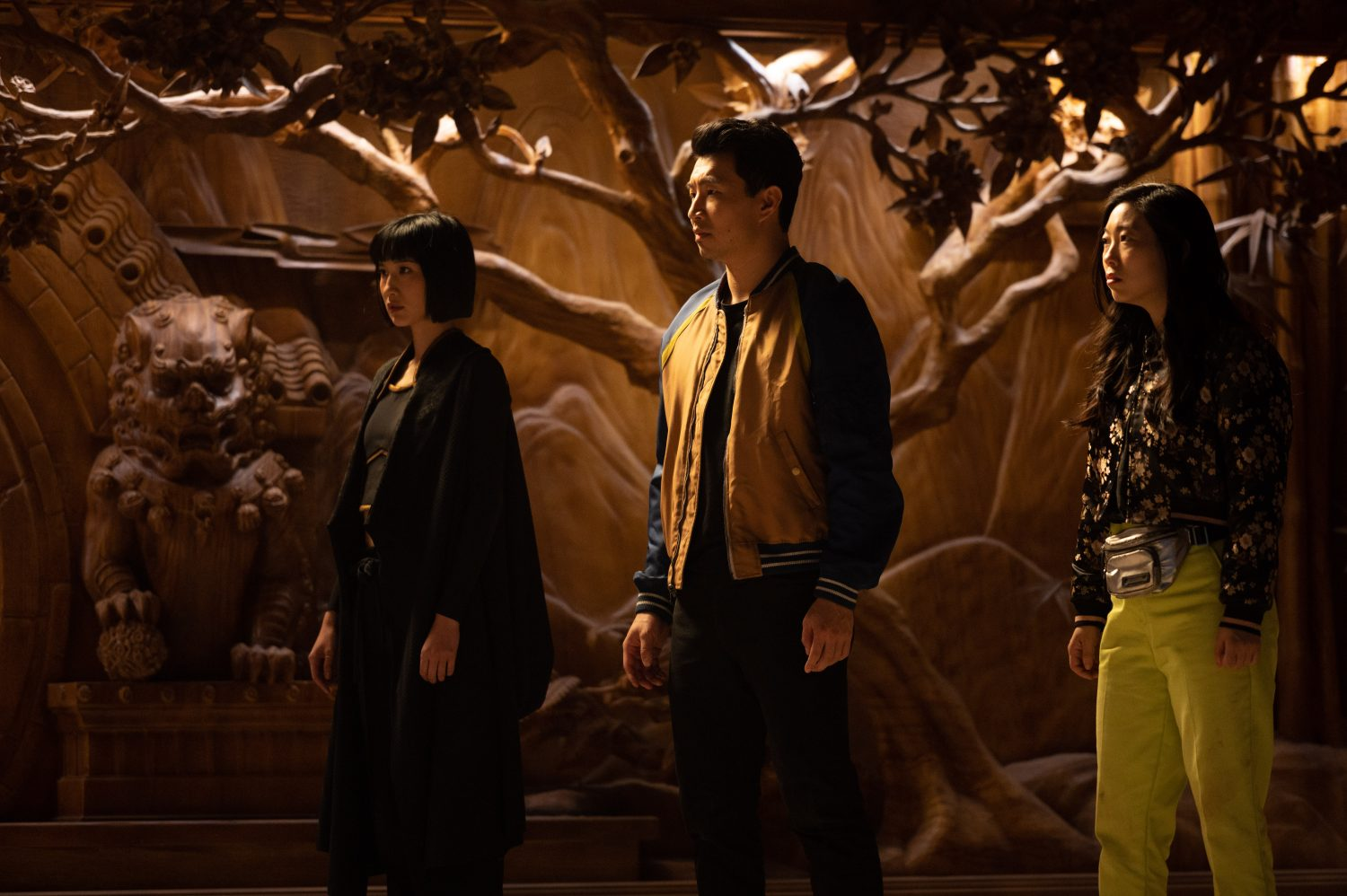 A still from 'Shang-Chi' of Shang-Chi, Xialing, and Katy learning about Ta Lo from Wenwu