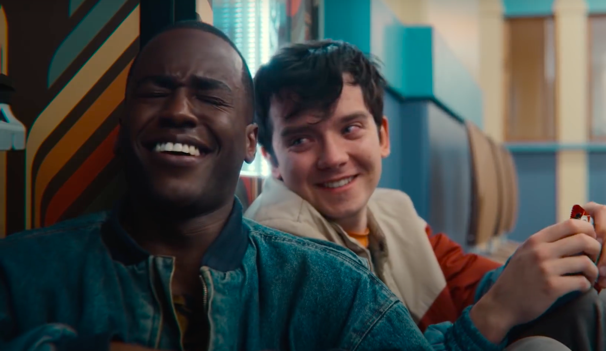 A still from Season 3 of Sex Education of Otis and Eric laughing