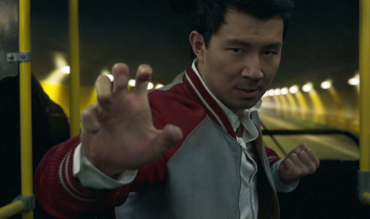 A still from 'Shang-Chi' of Simu Liu as Shang-Chi in a fighting stance on the bus