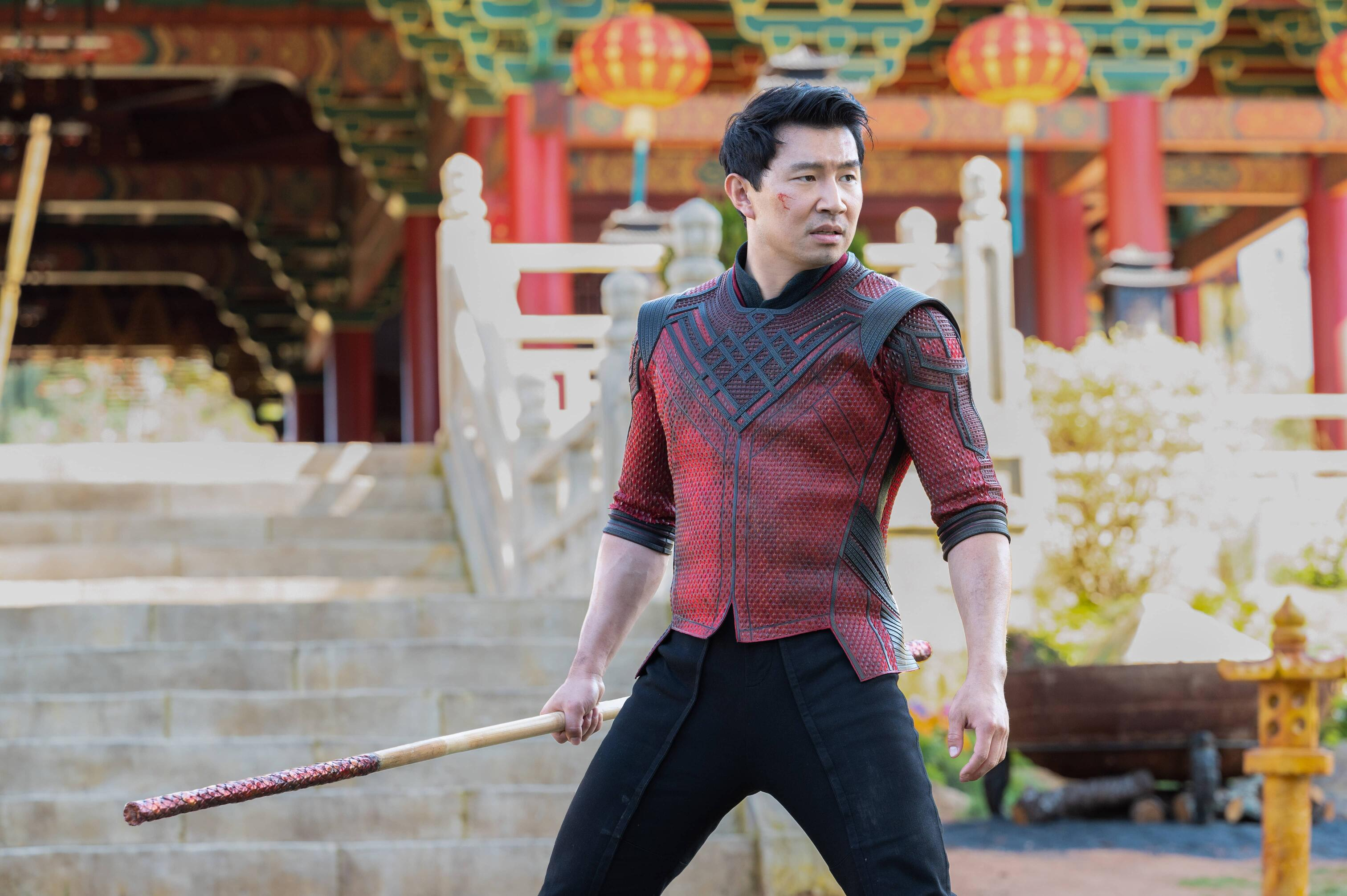 A still from 'Shang-Chi' of Simu Liu as Shang-Chi about to fight Wenwu