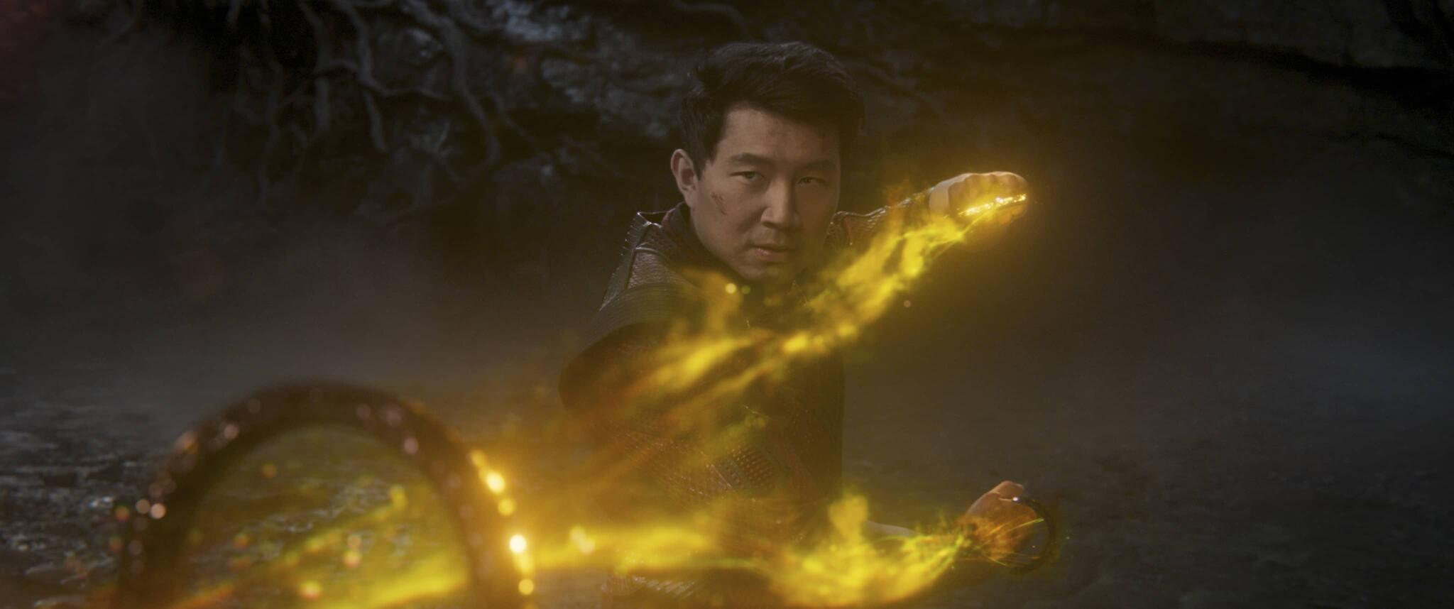 A still from 'Shang-Chi' of Shang-Chi using the Ten Rings against Wenwu