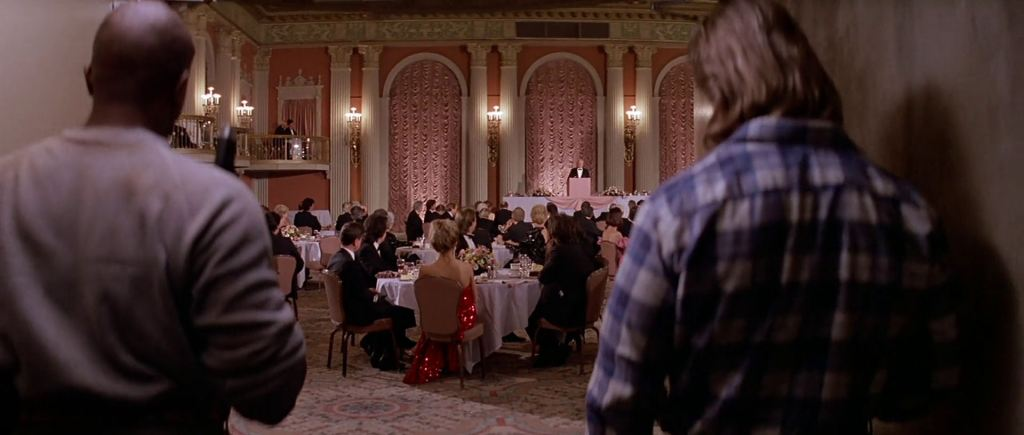 As Nada and Frank brave the hallway, they discover a room in which a banquet honors the aliens' alliance with the wealthy.